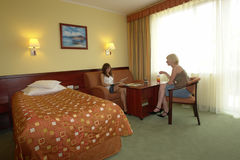 Teens chatting in hotel room Royalty Free Stock Photo