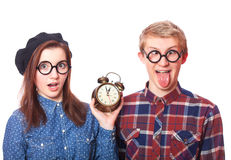 Teens with clock alarm. Stock Image
