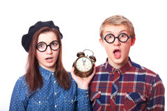 Teens with clock alarm. Royalty Free Stock Image