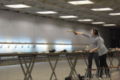 Teens  compete in shooting Stock Photo