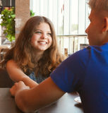 Teens couple in cafe close up portrait Stock Image