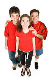 Teens and Dad in Red stock images