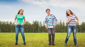 Teens Dancing in a Meadow Royalty Free Stock Photos