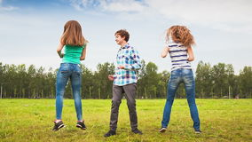 Teens Dancing in a Meadow. A young man and a young woman having fun stock footage