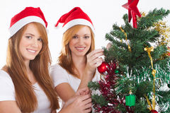 Teens decorating christmas tree Stock Photo