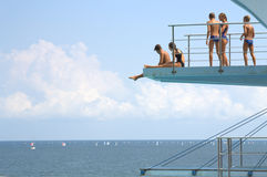 Teens on diving board Royalty Free Stock Photo