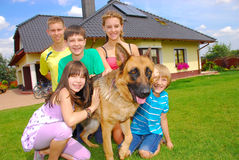 Teens with dog. By their home Royalty Free Stock Image