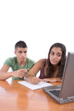 Teens doing homework Royalty Free Stock Image