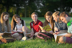 Teens Doing Homework Outdoors Royalty Free Stock Images