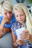 Teens and electronics Stock Photography