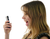 Teens emotions with mobile. Teen girl spontaneous reaction under mobile conversation Stock Photography