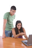Teens enjoying with a laptop Royalty Free Stock Photos