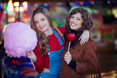Teens at fair with candy. Floss and toffee apple Stock Images