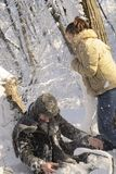 Teens fighting with snow balls Stock Images