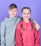 Teens friends. Girl and boy true friendship. Children smiling faces on violet background. Friends hug. Childrens day. Cheerful youth. Relations and friendship royalty free stock image