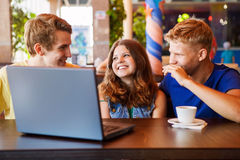 Teens friends spend time together in cafe Stock Photo