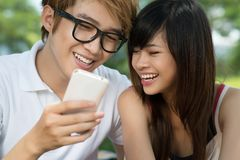 Teens with gadget Stock Photography