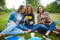 Teens with gadgets Royalty Free Stock Photography