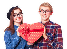 Teens with gift. Royalty Free Stock Images