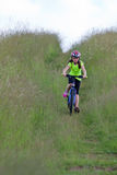 Teens girl on bike Royalty Free Stock Photo