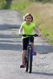 Teens girl on bike Royalty Free Stock Image