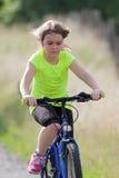 Teens girl on bike Stock Photo