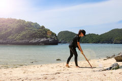 Teens girls drawing on the sand beach. Samui island Thailand,2017 July 5 Stock Photos