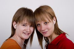 Teens girls listen MP3 music Stock Image