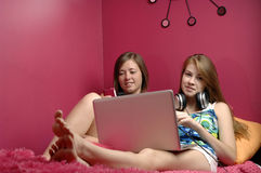 Teens girls using electronics Royalty Free Stock Image