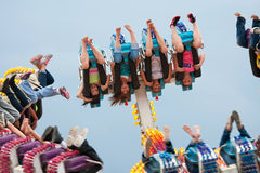 Teens Go Upside Down On Carnival Ride Stock Images