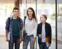 Teens going to school with papers Royalty Free Stock Photography