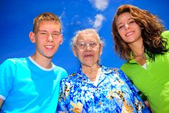 Teens with grandma. Teenagers with their grandma outside Stock Image