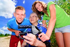 Teens and grandma. Teenagers with their grandma outside Stock Image