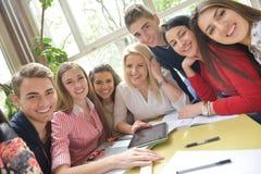 Teens group in school Stock Photos
