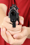 Teens hand  with gun, gangster Royalty Free Stock Photo