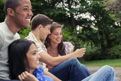 Teens hanging out together. Teenage friends spending time together Royalty Free Stock Photography