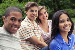 Teens hanging out together. Teenage friends spending time together Stock Photo
