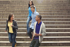 Teens hanging out together. Teenage friends spending time together Stock Images