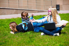 Teens having fun on campus Stock Image