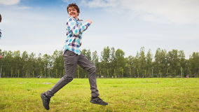 Teens Having Fun on the Meadow Royalty Free Stock Image