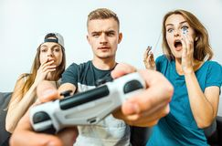 Teens Having Fun Playing Video Game Royalty Free Stock Photography