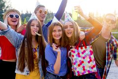 Teens having a party. Group of teens are having a birthday party Stock Images