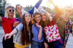 Teens having a party. Group of teens are having a birthday party Stock Photo