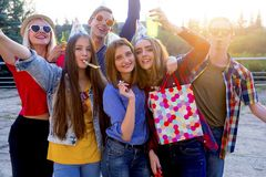 Teens having a party. Group of teens are having a birthday party Stock Photography