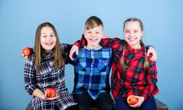 Teens with healthy snack. Healthy dieting and vitamin nutrition. Eat fruit and be healthy. Friends kids hug each other stock photo