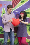 Teens with heart near graffiti wall. Royalty Free Stock Image