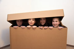 Teens hidden in moving box stock photography
