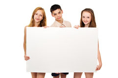Teens hold advertising poster Royalty Free Stock Photography