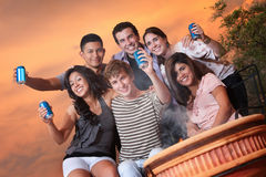 Teens Hold Cans Royalty Free Stock Image