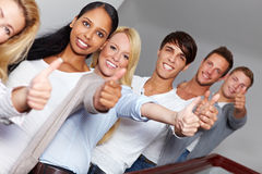 Teens holding their thumbs up Stock Image